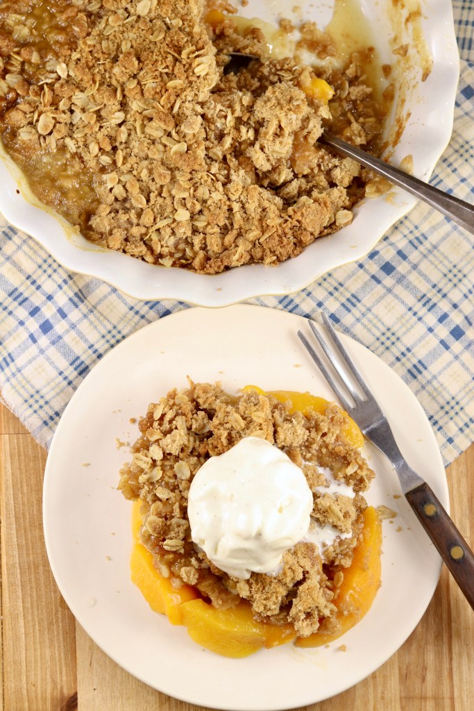 Easy fruit dessert made with peaches and a brown sugar oat topping.