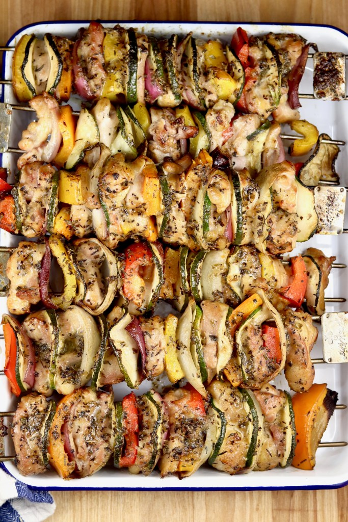 Grilled Chicken and vegetable kebabs on a white enamel tray