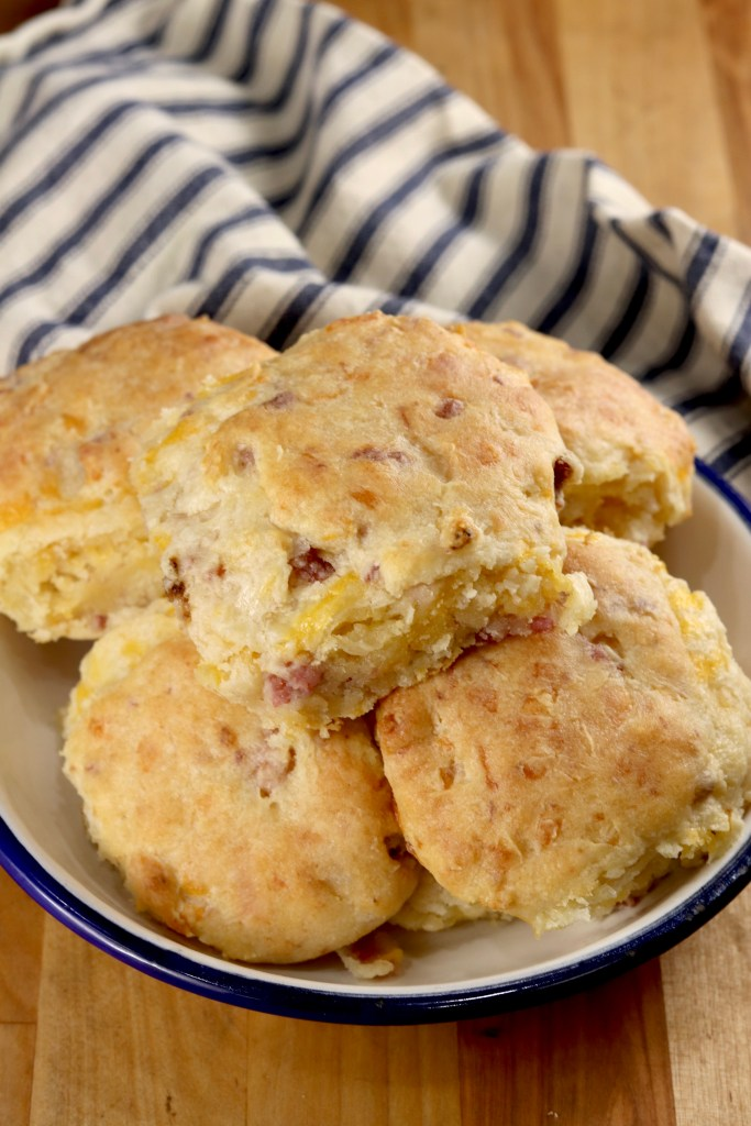 Buttermilk Biscuits with Ham and Cheese in a bowl with a striped towel