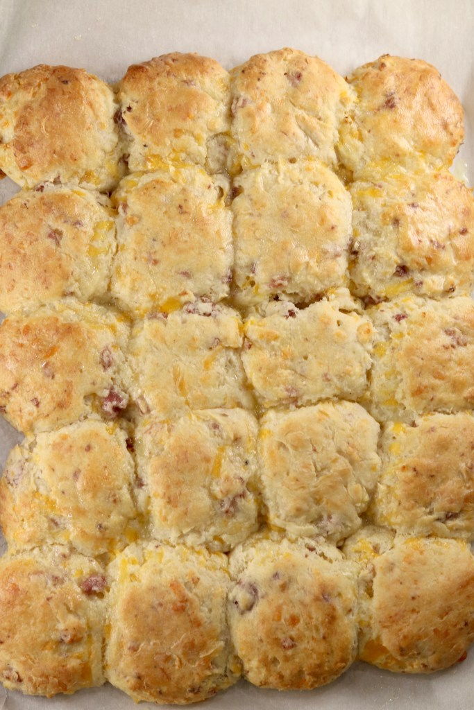 Baked pan of buttermilk biscuits with ham and cheese