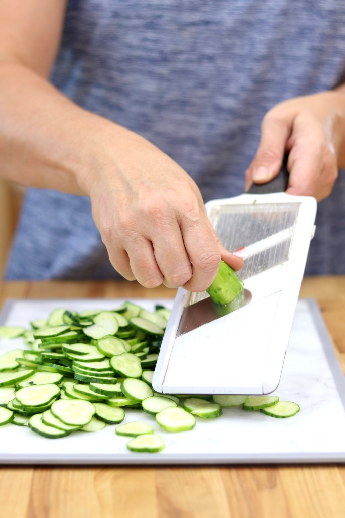 Slicing cucumbers with a mandoline slicer