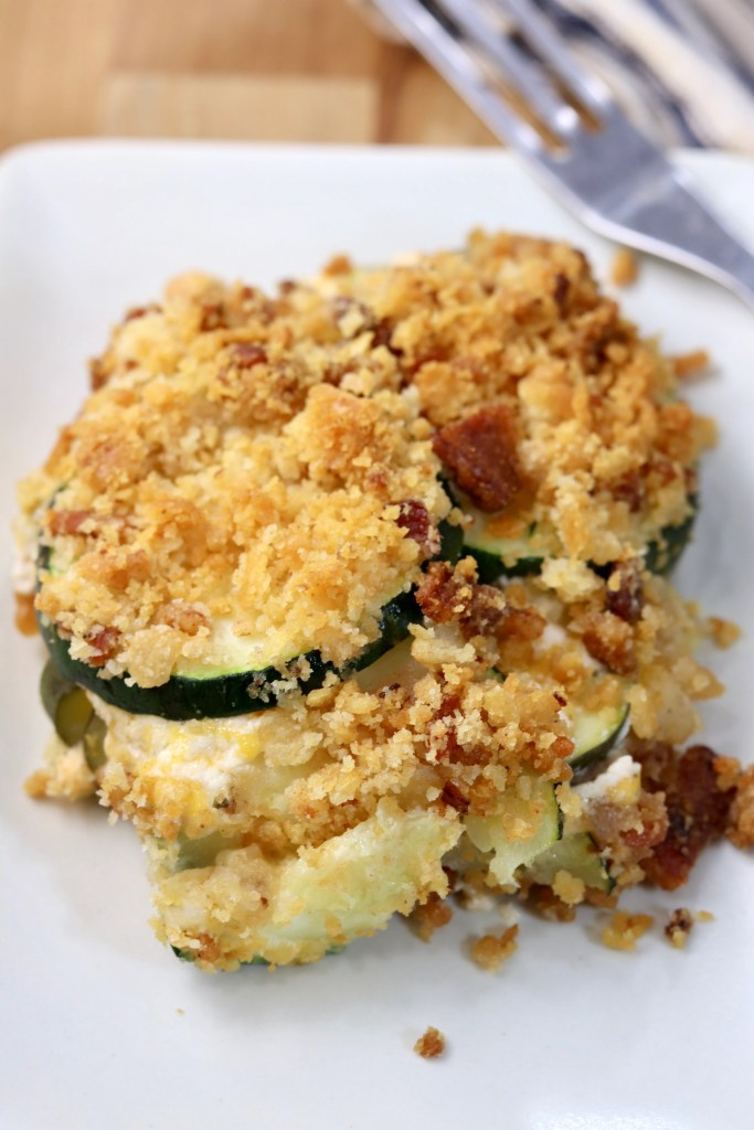 Zucchini jalapeno popper casserole with cracker topping on a plate