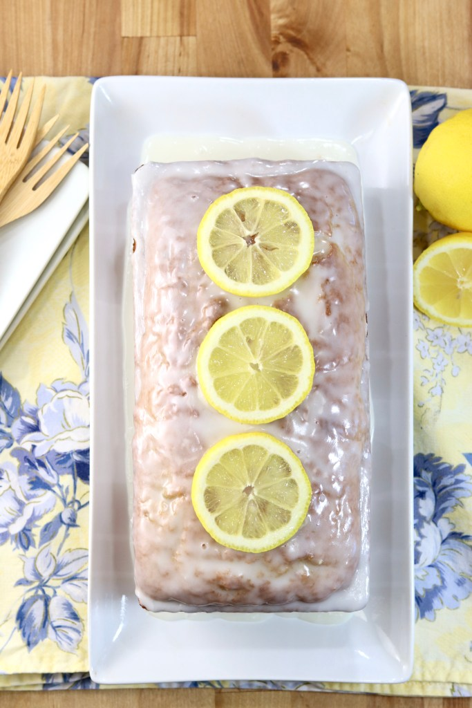 Glazed lemon zucchini cake with fresh lemon slices