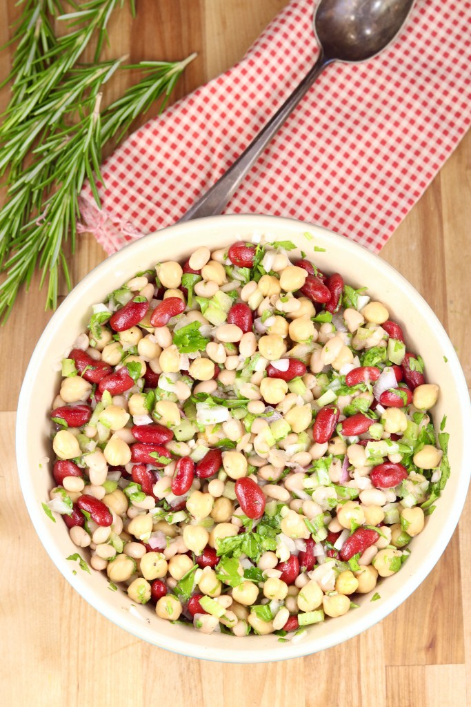 Red napkin with bean salad in a bowl