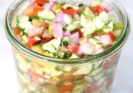 Jar of cucumber tomato salad