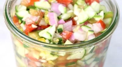 Jar of cucumber tomato salad