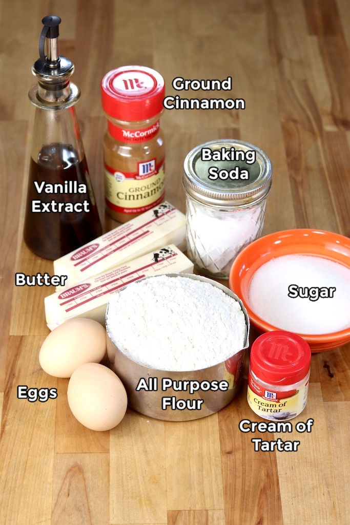 Ingredients with text labels for Snickerdoodles: Vanilla, Butter, Eggs, Sugar, Baking Soda, Cream of Tartar, Cinnamon
