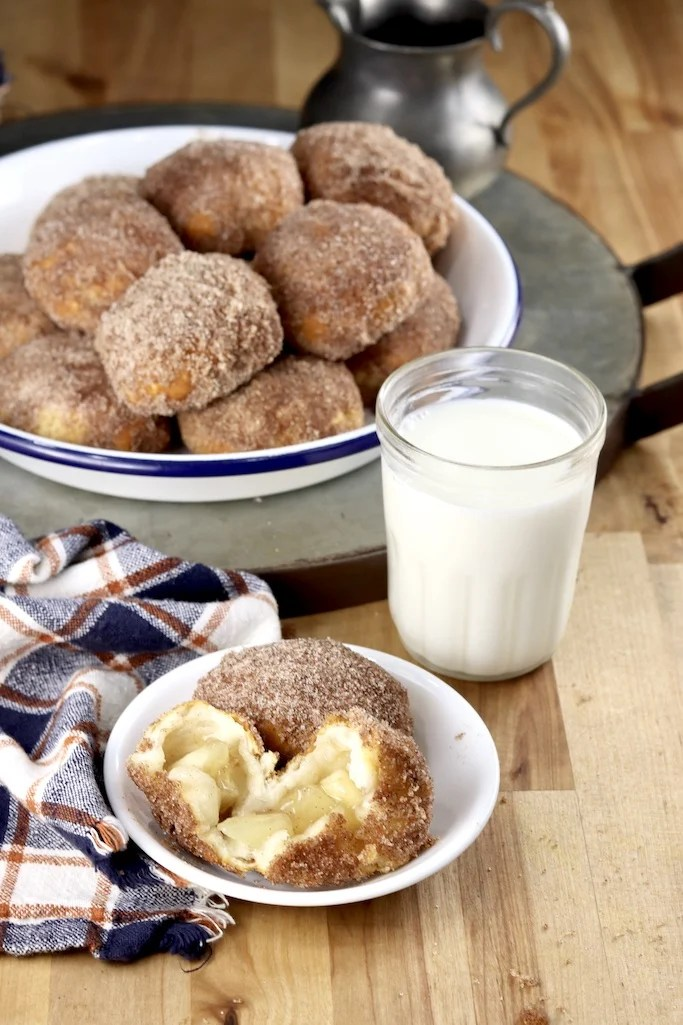 Churro Apple Pie Bombs with milk, one serving and pie plate filled