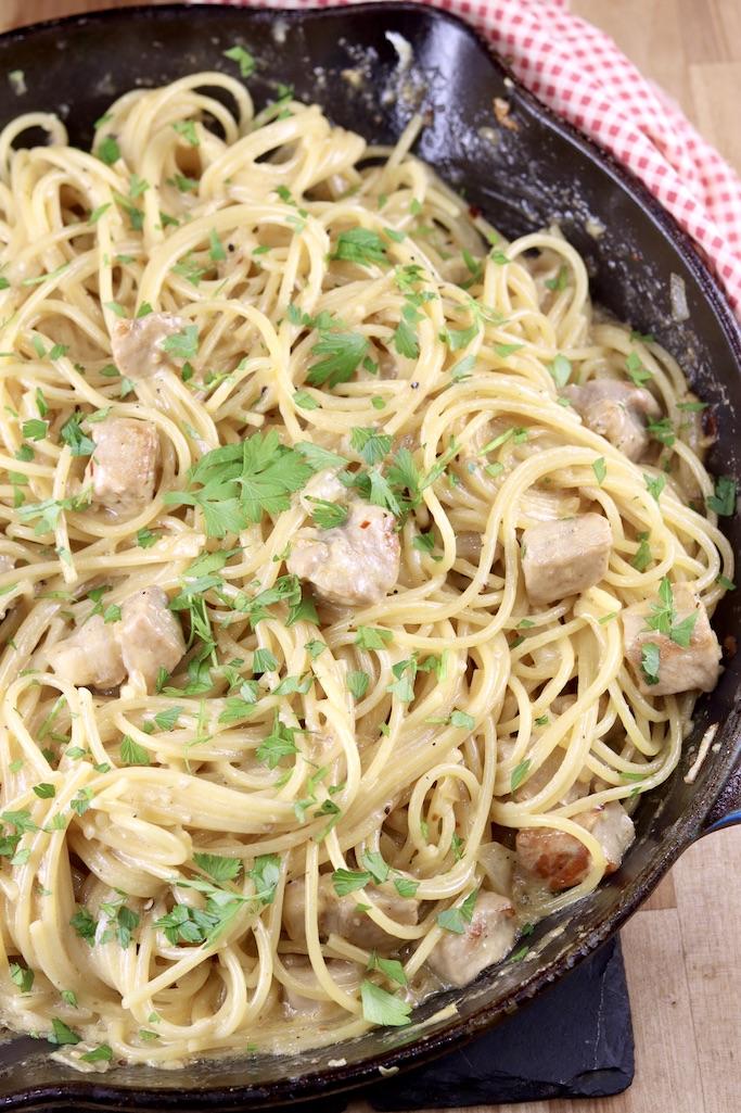 Skillet of spaghetti and pork chunks