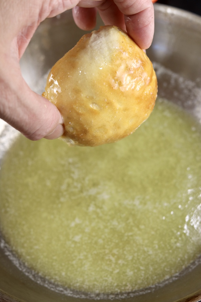 Dipping apple pie bomb in butter