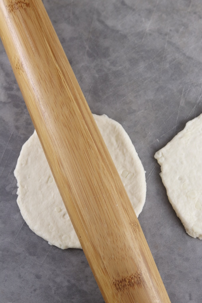 rolling pin rolling biscuit dough