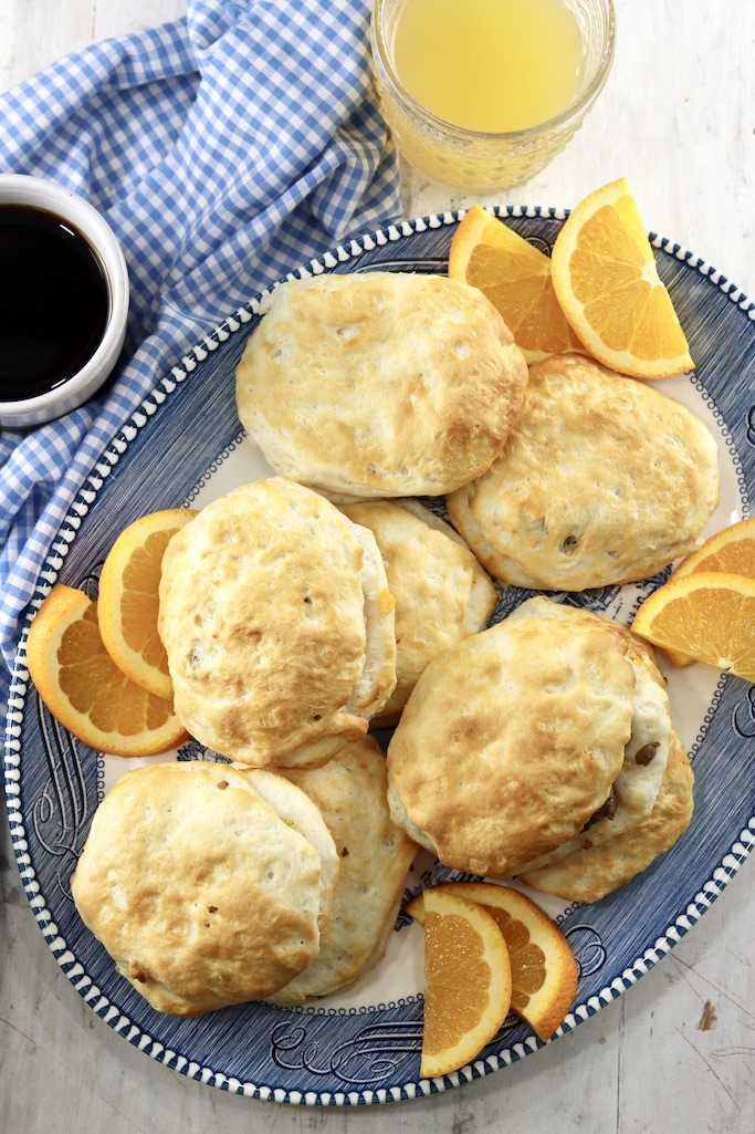 Breakfast biscuit pockets on a platter with coffee and juice