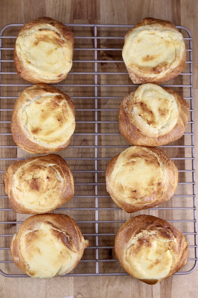 wire rack filled with 8 cheese danishes