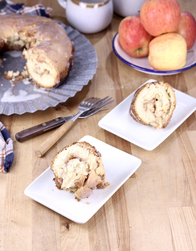 Sliced Apple Coffee Cake - 2 plates with cake platter and bowl of apples