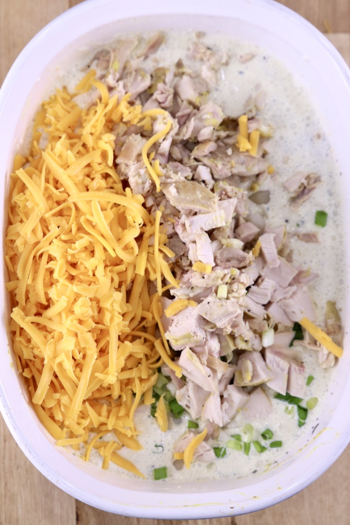 adding chicken and cheese in rice casserole