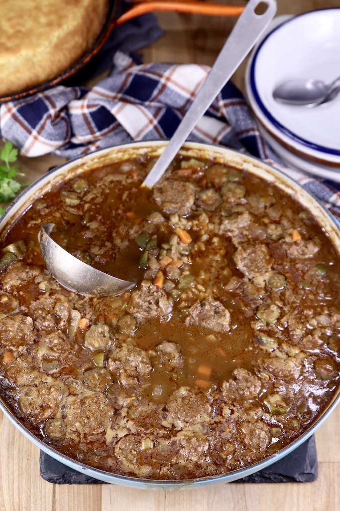 Smoked Sausage Barley Soup in a pan with a ladle