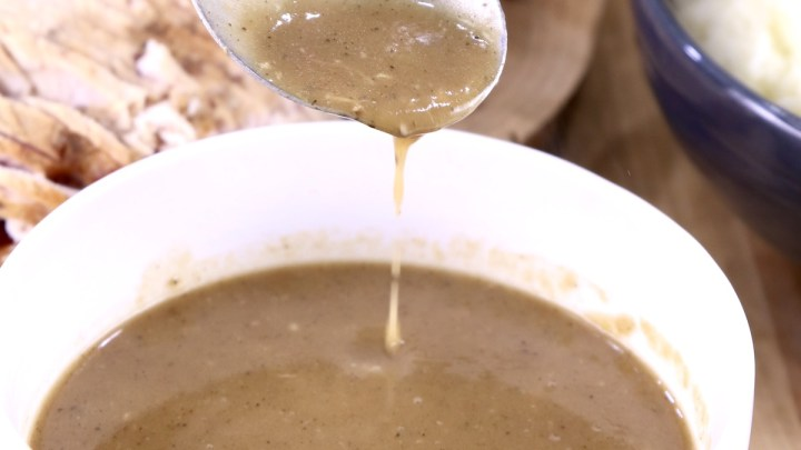 Brown Gravy in bowl with ladle dipping