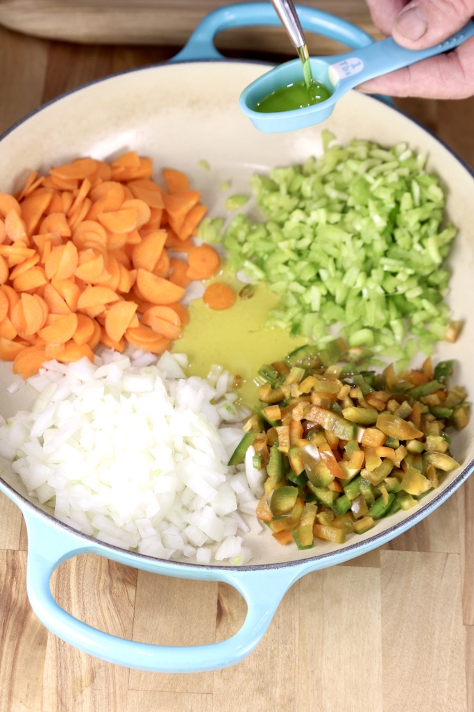 Diced carrots, celery, onions and bell peppers with olive oil in a pan