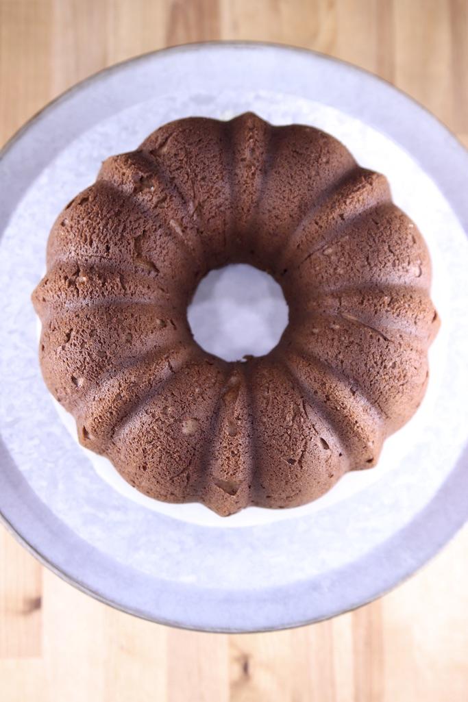 Chocolate bundt cake inverted onto serving plate