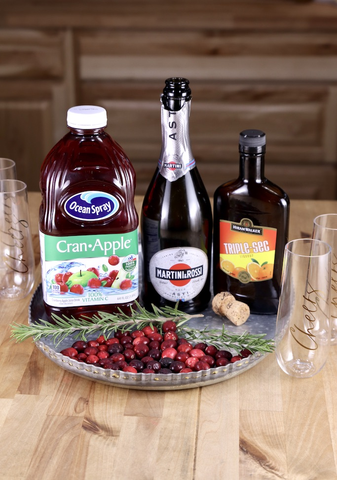 Ingredients for cranberry mimosa cocktails on a tray