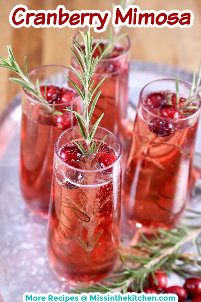 Cranberry Mimosas on a tray with rosemary garnish with text overlay