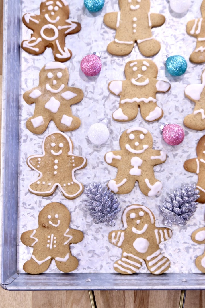 Gingerbread Men Cookies decorated on a tay with Christmas Ornaments