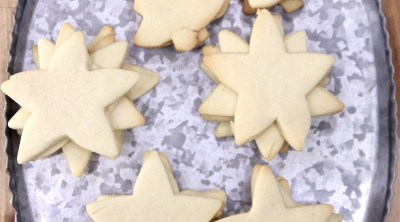 Cut out sugar cookies on a platter with Christmas shapes - trees, stars