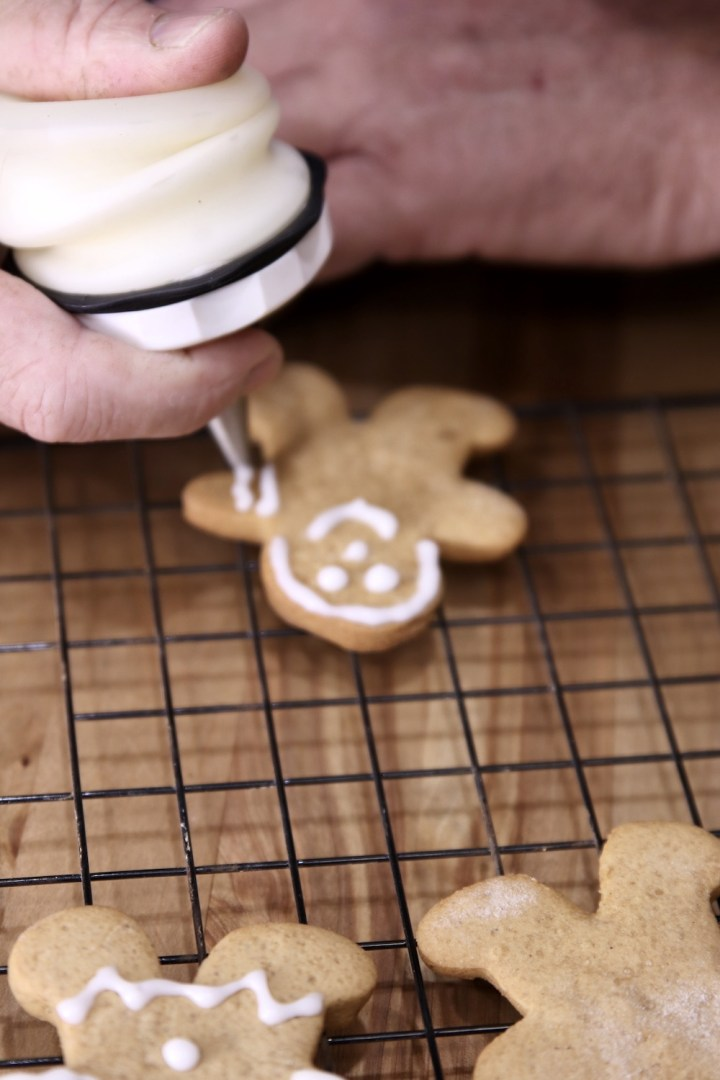 Piping icing onto gingerbread cookies