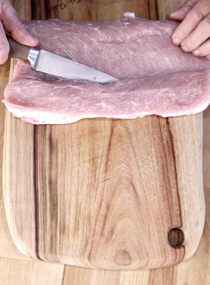 Slicing a pork tenderloin to stuff