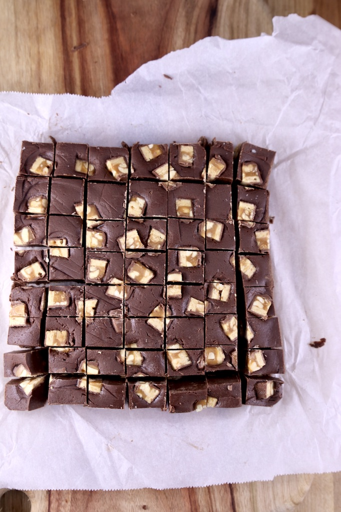 Sliced Snickers Fudge on Parchment Paper