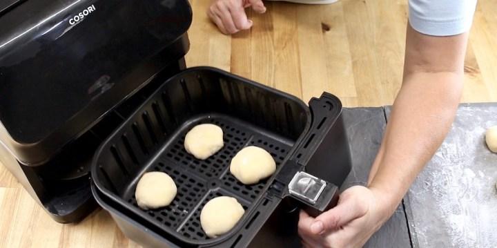 Cooking peach cobbler bombs in an air fryer basket
