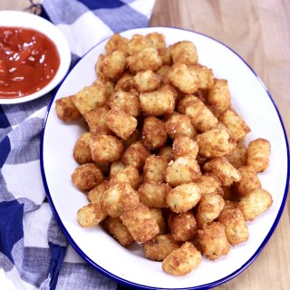 Tater Tots on a platter, cup of ketcup