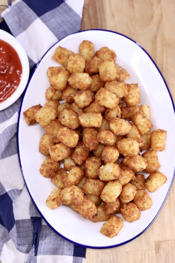 Tater tots on a platter served with ketchup