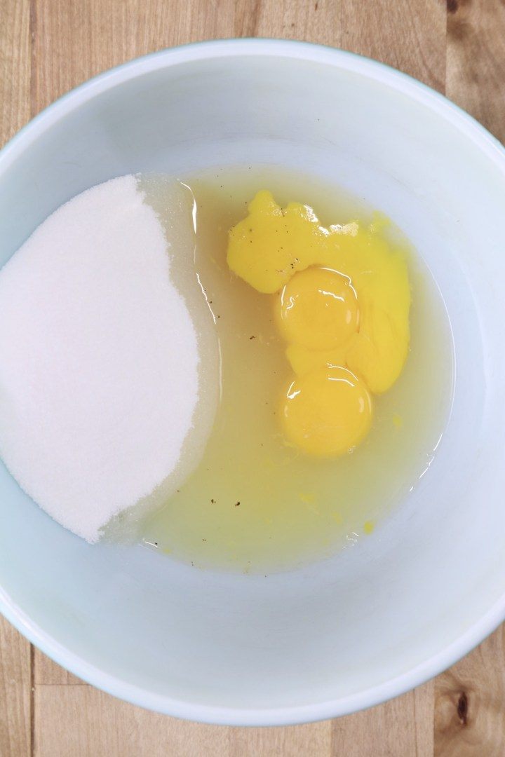 Bowl with sugar, eggs, pineapple juice and vanilla