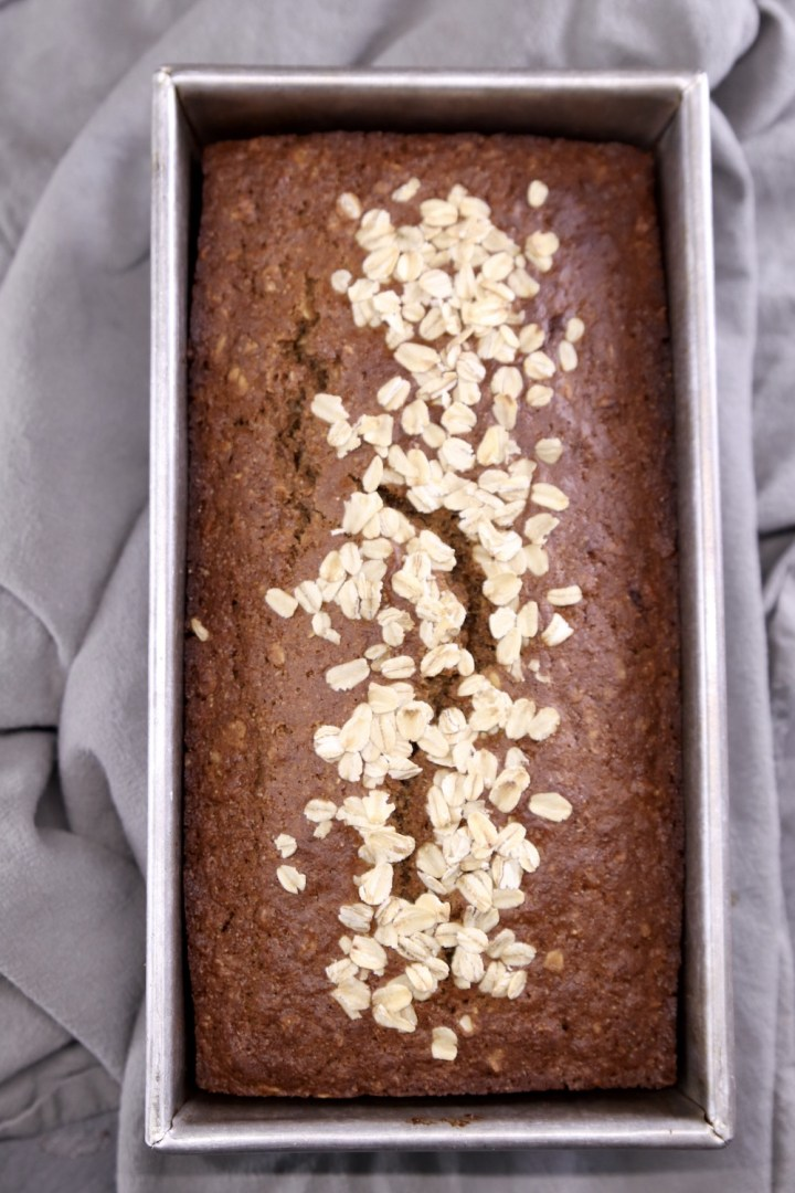 Loaf pan with baked Irish Brown Bread with oat topping