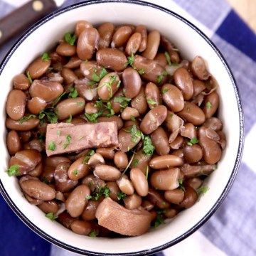 Bowl of pinto beans with chunks of ham