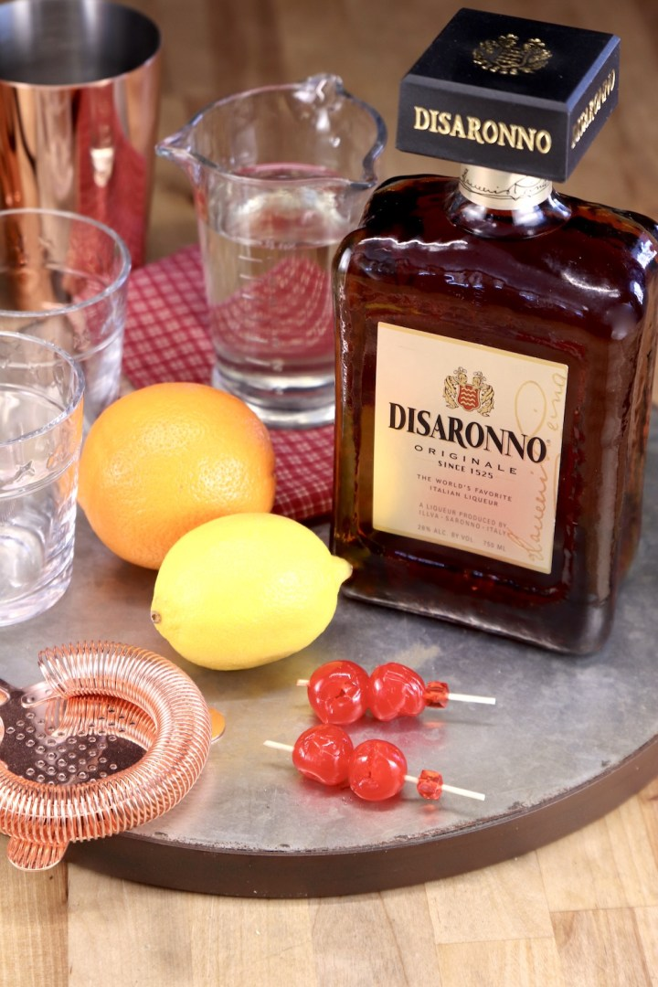 tray with Disaronno, lemon, orange, simple syrup and bar tools
