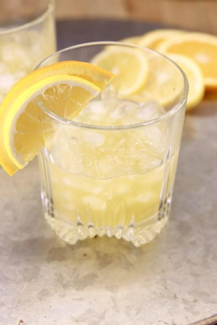 Amaretto Whiskey Sour cocktail garnished with lemon and orange slice