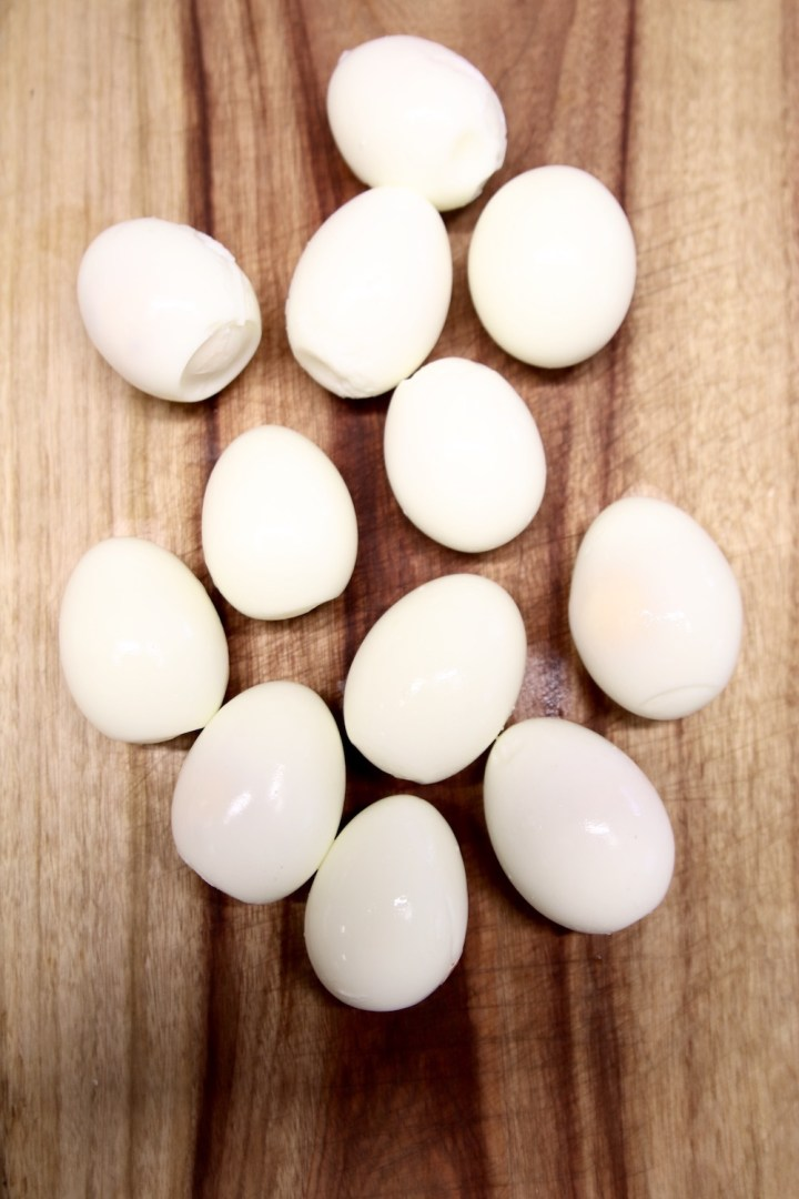 Boiled and peeled eggs on a cutting board