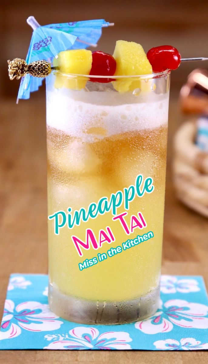 Pineapple Mai Tai Cocktail with drink umbrella and pineapple and cherry garnish