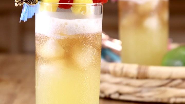 Pineapple Mai Tai Cocktail with pineapple and cherry garnish