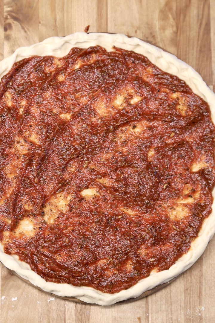 pizza dough with sauce