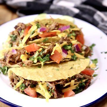 3 Pork Tacos with tomatoes, onion cilantro