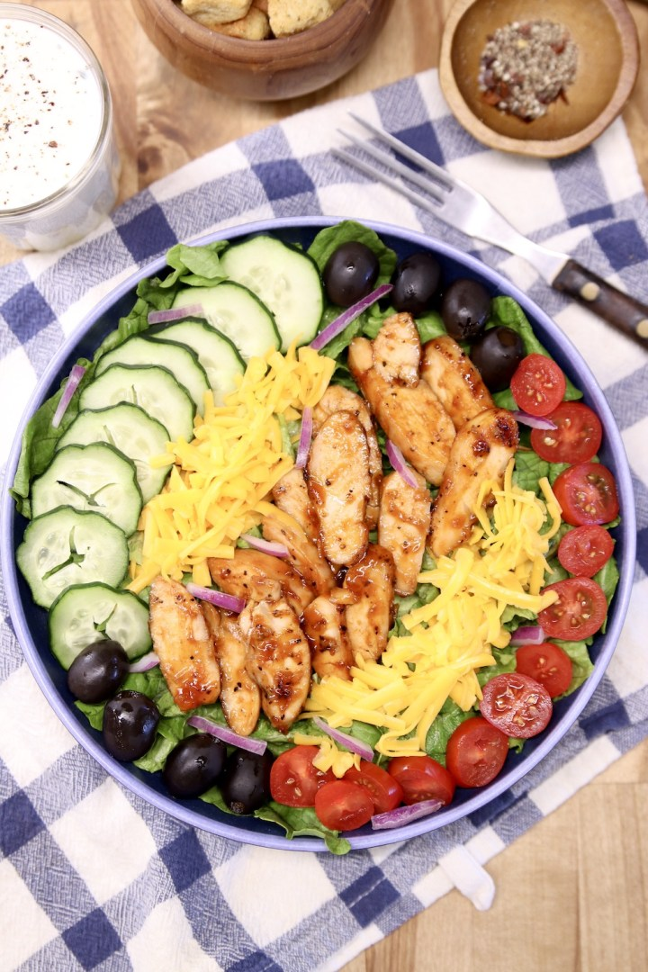 BBQ Chicken salad with ranch dressing and croutons to the side