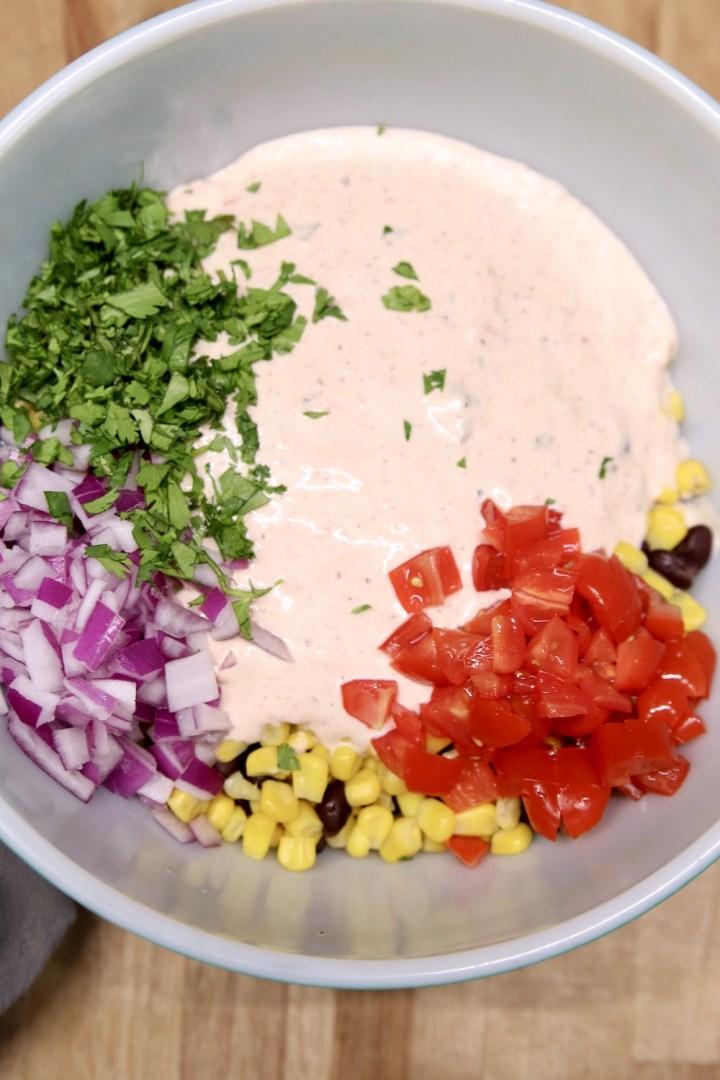 dressing and vegetables for black bean salad