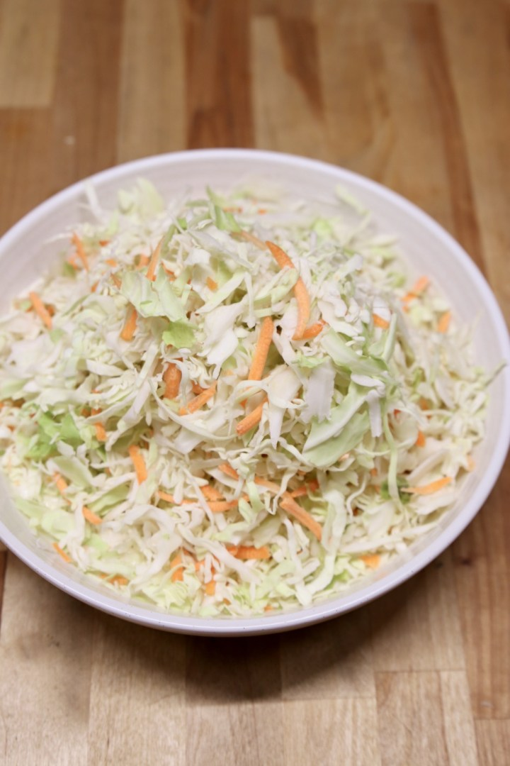 shredded cabbage and carrots in a bowl for coleslaw