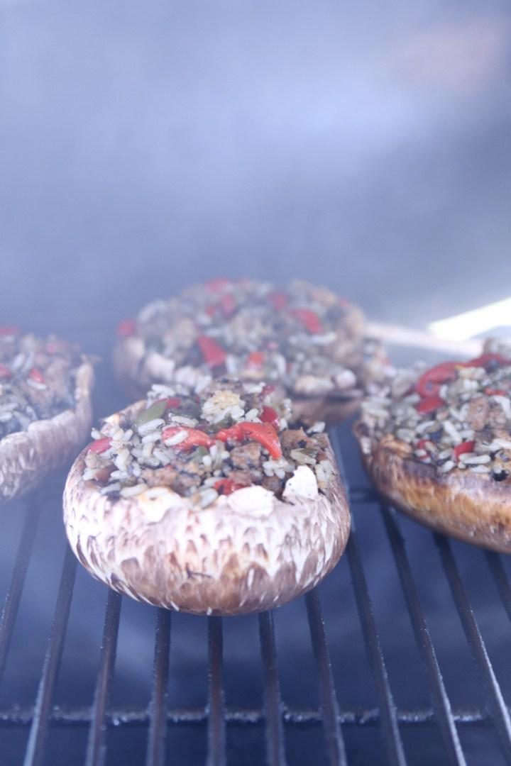 stuffed mushrooms on a grill