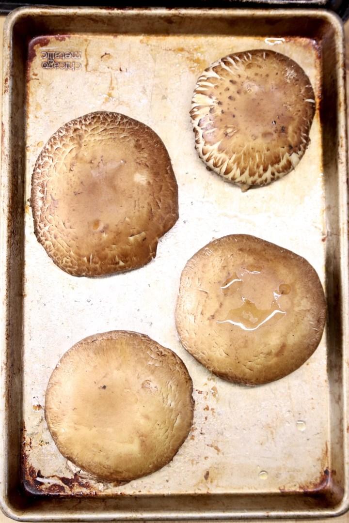 portobello mushrooms caps on a baking sheet