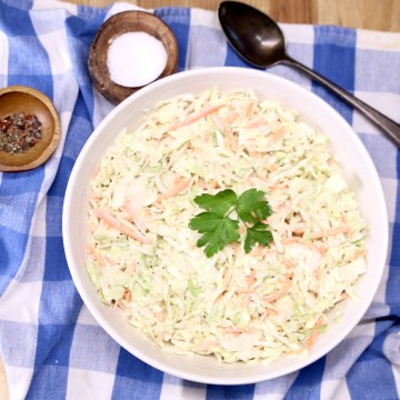 bowl of coleslaw on a blue check napkin