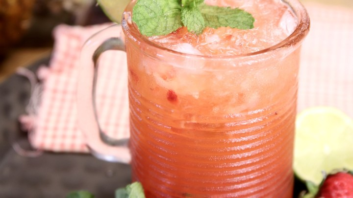 Strawberry Pineapple Mojito with mint, lime and strawberry garnish